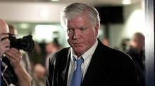 Toronto Maple Leafs general manager Brian Burke leaves the year end press briefing in Toronto Tuesday. (Chris Young/The Canadian Press/Chris Young/The Canadian Press)