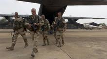 French soldiers exit a military plane at Bamako airport, Mali, on Jan. 13, 2013. (Jeremy Lempin/AP)