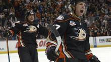 Anaheim defenceman Hampus Lindholm, right, celebrates with Teemu Selanne in a game against the San Jose Sharks on April 9. (Kirby Lee/USA Today Sports)
