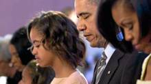 President Obama and his family pray during Easter services at Allen Chapel AME Church in Washington on April 4, 2010. (White House)