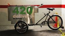 "A marijuana delivery bike is shown in this recent handout photo. The public may be used to seeing ice cream carts or beer carts at events on hot summer days, but not carts selling illicit substances. Victoria Police say they arrested a man pedalling a marijuana cart that was decorated with the name ""420 Delivery"" in large type on the sides. The number 420 is a widely used code term for marijuana use. (HO/THE CANADIAN PRESS)"