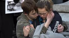 Friends embrace as several hundred people attend a community vigil to remember Rehtaeh Parsons at Victoria Park in Halifax on April 11, 2013. (Andrew Vaughan/THE CANADIAN PRESS)