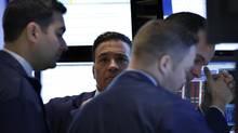 Traders work on the floor at the New York Stock Exchange June 20, 2013. (BRENDAN MCDERMID/REUTERS)