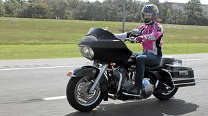 Jessica Phillips and a 2005 Harley Davidson Road Glide.
