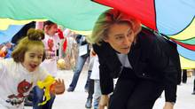 Ursula von der Leye, Germany's Minister of Family Affairs, joins the fun at a Berlin Kindergarten. (Franka Bruns/AP2008)