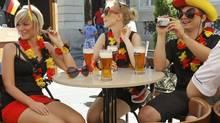 Young German soccer fans sit in a bar in central Lviv June 17, 2012. (GLEB GARANICH/REUTERS)