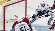William Nylander, right, scores past Montreal Canadiens goalie Zachary Fucale during NHL pre-season hockey action. Nylander was called up to the Maple Leafs from the AHL Marlies on Monday. (Paul Chiasson/THE CANADIAN PRESS)