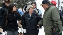 Attawapiskat Chief Theresa Spence is helped back to her teepee after greeting and welcoming supporters as they visit her on Victoria Island in Ottawa on Thursday, January 3, 2013. (Sean Kilpatrick/THE CANADIAN PRESS)