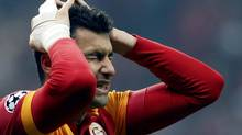 Galatasaray's Burak Yilmaz reacts after he missed a chance to score against Schalke 04 during their Champions League soccer match at Turk Telekom Arena in Istanbul February 20, 2013. (OSMAN ORSAL/REUTERS)