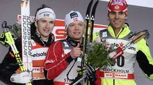 t placed Eirik Brandsdal (C) of Norway, Second placed Teodor Peterson (L) of Sweden and third placed Len Valjas of Canada pose on the podium after winning the Men's 1 km Classic Sprint Final at the FIS Cross-Country World Cup in Stockholm March 14, 2012. REUTERS/Claudio Bresciani (Claudio Bresciani/Reuters)