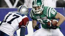 In this November 28, 2010 photo, slotback Andy Fantuz (right) makes a move on Montreal Alouettes defensive back Billy Parker in CFL Grey Cup action in Edmonton. Fantuz says he's signed with the Hamilton Tiger-Cat. THE CANADIAN PRESS/Adrian Wyld (Adrian Wyld)