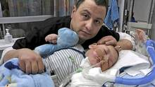 Moe Maraachli, sits by his terminally ill baby, Joseph. The baby is being kept alive in by a breathing tube in a London hospital. (Facebook photo/Facebook photo)