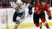 Vancouver Canucks' Jannik Hansen, left, skates past Chicago Blackhawks' Kris Versteeg during the first period of Game 1 of an NHL hockey Western Conference second-round playoff series Saturday, May 1, 2010, in Chicago. (AP Photo/Nam Y. Huh) (Nam Y. Huh)