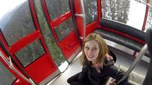 An image taken from a video posted online shows a woman next to the open doors of a Whistler gondola after a thrill-seeker wearing a head-mounted camera jumped.