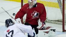 Canada goalie Zachary Fucale, right, makes a save on a shot from CIS Toronto Selects forward Andrew Buck (17) during second period exhibition hockey action at the world Juniors selection camp in Toronto on Saturday, Dec. 14, 2013. (NATHAN DENETTE/THE CANADIAN PRESS)