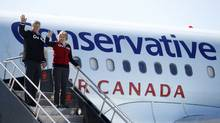 Conservative leader and Canada's Prime Minister Stephen Harper waves as he boards his campaign plane with his wife Laureen in Ottawa April 3, 2011. Canadians will head to the polls in a federal election May 2. (Chris Wattie/Reuters/Chris Wattie/Reuters)