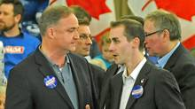 Guelph Conservative candidate Marty Burke, left, chats with his director of communications Michael Sona before the Here for Canada rally April 4, 2011 in Guelph, Ontario. (Greg Layson/Guelph Mercury/The Canadian Press/Greg Layson/Guelph Mercury/The Canadian Press)