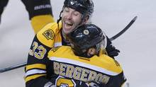 Boston Bruins' Patrice Bergeron celebrates with teammate Zdeno Chara (L) after scoring the overtime winner against the Toronto Maple Leafs in Game 7 of their NHL Eastern Conference quarter-final hockey playoff series in Boston, Massachusetts May 13, 2013. (BRIAN SNYDER/REUTERS)