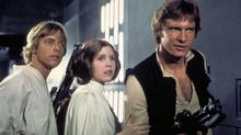 Carrie Fisher as Princess Leia with Mark Hamill as Luke Skywalker in the first of the Star Wars film franchise. (HO/CP)