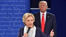 Republican presidential candidate Donald Trump listens to Democratic presidential candidate Hillary Clinton during the second presidential debate at Washington University in St. Louis, Missouri on October 9, 2016. (PAUL J. RICHARDS/AFP/Getty Images)