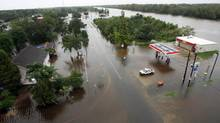 Waters flood the streets near a gas station as Tropical Storm Lee slowly makes landfall in Lafitte, Louisiana September 4, 2011. (DAN ANDERSON/Reuters)