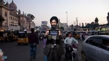 Datawind CEO Suneet Singh Tuli shows off the Aakash tablet in Mumbai (daryl visscher/redux pictures/Daryl Visscher/Redux Pictures)