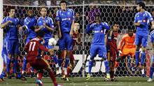 Montreal Impact players form a wall as Real Salt Lake's Javier Morales fires a penalty kick at the goal during the second half of an MLS soccer match, Wednesday, April 4, 2012, in Sandy, Utah. (Steve Griffin/Associated Press)