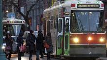 Rush hour traffic including TTC vehicles on Spadina Avenue in Toronto on Nov. 29, 2013. (Deborah Baic/The Globe and Mail)