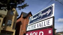 Economists have been surprised by the degree to which home sales have bounced back from the pounding they took in the summer of 2012, when Finance Minister Jim Flaherty tightened the mortgage insurance rules. (PETER POWER/THE GLOBE AND MAIL)
