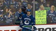Fans react to Vancouver Canucks Alex Burrows (ANDY CLARK/REUTERS)