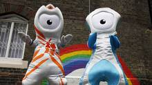 The 2012 Olympic mascot Wenlock (left) and Paralympic mascot Mandeville pose for photographers in the playground at St. Paul's primary school in London May 19, 2010. (SUZANNE PLUNKETT/REUTERS)