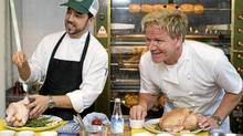 Chef Gordon Ramsay, right, speaks to reporters during a cooking demonstration at his new restaurant Laurier Gordon Ramsay, in Montreal, Tuesday, Aug. 9, 2011, as head chef Guillermo Russo looks on. (Graham Hughes/CP)