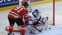 Canada's Steven Stamkos tries to tuck the puck past Slovenia's goalie Luka Gracnar during preliminary round action Monday, May 13, 2013 at the world hockey championship in Stockholm. (JACQUES BOISSINOT/THE CANADIAN PRESS)