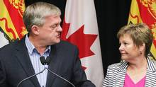 Former New Brunswick premier David Alward announces his resignation as leader of the Progressive Conservative party of New Brunswick as his wife Rhonda looks on during a news conference. (James West/The Canadian Press)