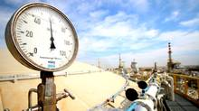 A general view shows pipelines in the newly opened section of the oil refinery of Zubair, southwest of Basra in southern Iraq, on March 3, 2016. (HAIDAR MOHAMMED ALI/AFP/Getty Images)