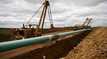 TransCanada Corp.'s Keystone XL pipeline: Bottlenecks could pressure prices lower and slow development, IEA says. (NATHAN VANDERKLIPPE/THE GLOBE AND MAIL)