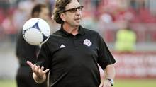 Toronto FC's head coach Paul Mariner bounces a ball on the sideline during the first half of their MLS match against the Colorado Rapids in Toronto July 18, 2012. (MIKE CASSESE/REUTERS)