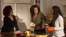 Mo'Nique, left, uses her talents mostly for comic good as Aunt May in Almost Christmas, which also stars Kimberly Elise, centre, and Gabrielle Union.