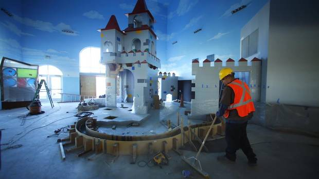 A worker sweeps the lobby entrance on Jan. 17, 2013 as construction continues on North America's first Lego Hotel, being built at the entrance to the Legoland theme park in Carlsbad, Calif. (MIKE BLAKE/REUTERS)