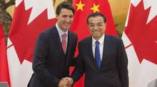 Chinese Premier Li Keqiang shakes hands with Prime Minister Justin Trudeau after a joint news conference this summer in Beijing. Li Keqiang is to visit Canada Sept. 21-24. (Adrian Wyld/The Associated Press)