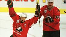 Wayne Gretzky celebrates Canada's first goal scored by Eric Lindros(R) during the first period of game one of the World Cup of Hockey final September 10, 1996. (Steve Falk/REUTERS)