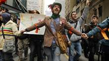 Thousands of people took part in a peaceful protest as part of Occupy Toronto on Oct. 15, 2011. The day began with a gathering in the financial district followed by a march to St. James Park where speeches, music, and performances took place around the park while tents were set up for accommodation, first aid, and food and water distribution. (Peter Power/Peter Power/ The Globe and Mail)