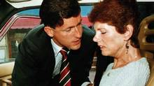 Sue Rodriguez is consoled by NDP MP Svend Robinson after leaving a press conference in Victoria, Sept. 30, 1993. The Supreme Court of Canada turned down Ms. Rodriguez's plea for a doctor- assisted suicide. (Jeff Vinnick/ Reuters/Jeff Vinnick/ Reuters)
