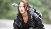 Jennifer Lawrence portrays Katniss Everdeen in a scene from The Hunger Games. (Murray Close /Associated Press/Murray Close/Associated Press)
