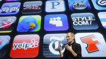 Deceased Apple Inc. Chief Executive Steve Jobs speaks in front of a display showing icons of various apps during the iPhone OS4 special event at Apple headquarters in Cupertino, California in this April 8, 2010 file photo. (ROBERT GALBRAITH/REUTERS)