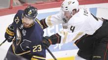 Buffalo Sabres forward Ville Leino, left, and Anaheim Ducks defender Cam Fowler battle during an NHL game in Finalnd. (Martti Kainulainen/Associated Press)