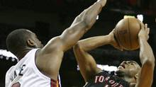 Miami Heat's Dwyane Wade defends as Toronto Raptors' Jarrett Jack shoots during the second quarter of an NBA basketball game in Miami, Sunday, March 28, 2010. (AP Photo/Jeffrey M. Boan) (Jeffrey Boan)