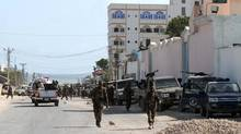 Somali government soldiers patrols the scene of an explosion in the capital of Mogadishu Sept. 12, 2012. (OMAR FARUK/REUTERS)