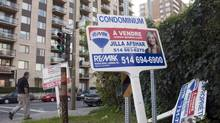 For sale signs stand in front of a condominium Tuesday, September 27, 2011 in Montreal. (Ryan Remiorz/THE CANADIAN PRESS)