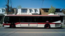 A hybrid TTC bus stops on Landsdowne avenue in this May 2008 photo. The TTC has suspended an employee after a video surfaced showing a driver taking a mid-route seven minute coffee break. (Sami Siva)